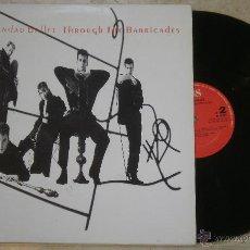 Discos de vinilo: LP THROUGH THE BARRICADES - SPANDAU BALLET - LP CBS - 1986 . Lote 53846271
