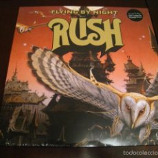Discos de vinilo: RUSH - FLYING BY NIGHT - LP - DIRECTO 1974 - VINILO NARANJA - EDICION 500 COPIAS. Lote 139517614