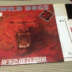 Discos de vinilo: WILD DOGS - REIGN OF TERROR LP SPAIN ENIGMA 1987 - ENCARTE HARD ROCK HEAVY METAL. Lote 57781720