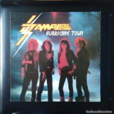 Discos de vinilo: STAMPEDE - HURRICANE TOWN - LP VINILO. POLYDOR 1983. EDICIÓN BRITÁNICA. (HEAVY METAL. HARD ROCK). Lote 64554879