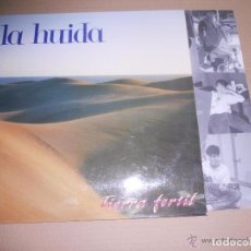 Discos de vinilo: LA HUIDA - TIERRA FERTIL (LA ROSA RECORDS 528017 LP 1992) . Lote 68385785