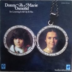 Discos de vinilo: DONNY & MARIE OSMOND-I'M LEAVING IT ALL UP TO YOU, MGM RECORDS-23 15 307. Lote 73030423