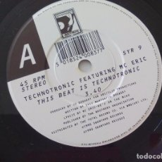Discos de vinilo: TECHNOTRONIC FEATURING MC ERIC THIS BEAT IS. 1990 SWANYARD RECORDS SINGLE VINILO. Lote 74415819