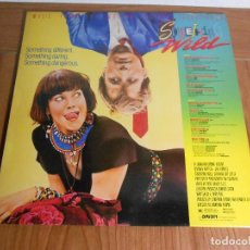 Discos de vinilo: LP MUSIC FROM THE MOTTION PEICTURE SOUNDTRACK (SOMETHING WILD) MCA-1986. Lote 87693280