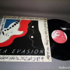 Discos de vinilo: 918- LA EVASIÓN -ELLA ES UN BOOMERANG - DISCO VINILO LP - PORTADA VG + DISCO VG+/++. Lote 97792207