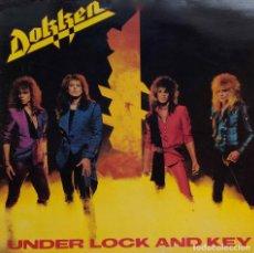 Discos de vinilo: DOKKEN. UNDER LOCK AND KEY. LP ESPAÑA CON FUNDA INTERIOR CON LETRAS.. Lote 98221335