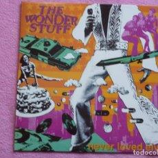 Disques de vinyle: THE WONDER STUFF,NEVER LOVED ELVIS EDICION ESPAÑOLA DEL 91. Lote 114519627