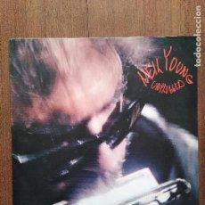 Discos de vinilo: LP NEIL YOUNG UNPLUGGED + LIBRO CON LAS LETRAS. Lote 118707155
