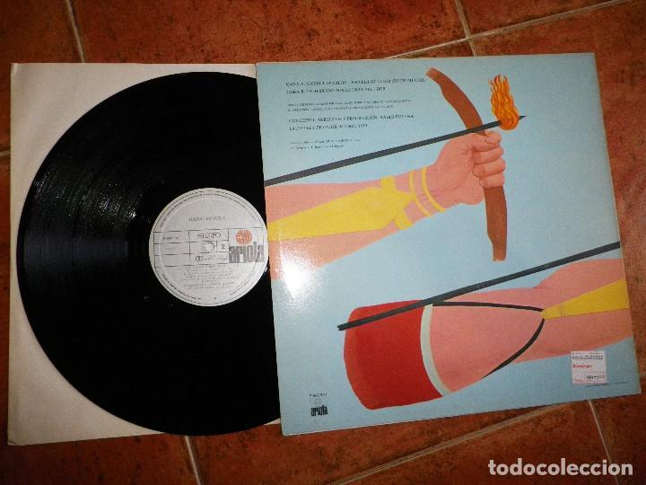 Discos de vinilo: RADIO FUTURA Escuela de calor / Un africano por la gran via MAXI SINGLE VINILO 1984 SANTIAGO AUSERON - Foto 2 - 120956663