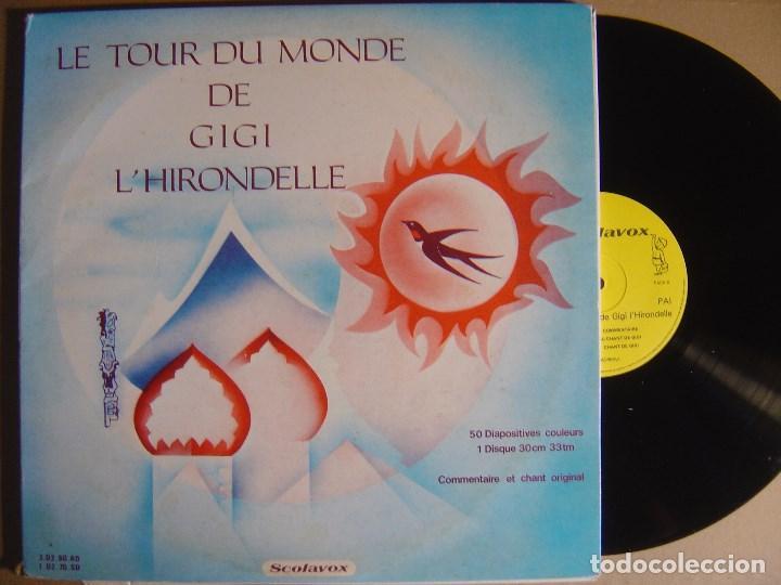 LE TOUR DU MONDE DE GIGI L´HIRONDELLE - LP FRANCES CON 50 DIAPOSITIVAS - SCOLAVOX (Música - Discos - LPs Vinilo - Música Infantil)