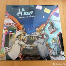 Discos de vinilo: LP LA PLEBE BRAZO EN BRAZO 2010 PUNK SKA HARDCORE. Lote 128315727