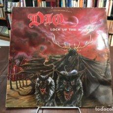 Discos de vinilo: LOCK UP THE WOLVES. DIO LP 1990. Lote 133744910