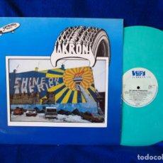 Discos de vinilo: THE AKRON COMPILATION - VARIOS ARTISTAS - LP STIFF RECORDS 1979 - VINILO COLOR VERDE AZULADO - . Lote 134944570