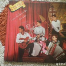 Discos de vinilo: LP. OLE OLE. CUATRO HOMBRES PARA EVA. FIRMADO POR MARTA SANCHEZ Y GRUPO. . Lote 140072290