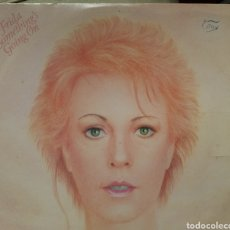 Discos de vinilo: FRIDA THERE'S SOMETHING GOING ON LP ABBA. Lote 140463016