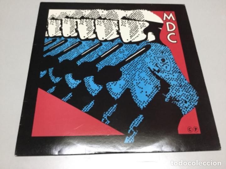 MCD - MILLIONS OF DEAD COPS . REF 381 (Música - Discos - LP Vinilo - Punk - Hard Core)