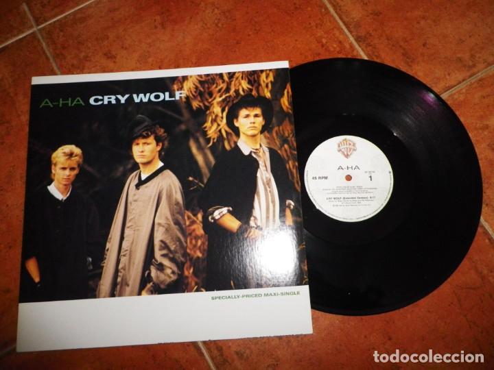 AHA CRY WOLF A-HA MAXI SINGLE VINILO DEL AÑO 1986 CANADA CONTIENE 3 TEMAS MUY RARO (Música - Discos de Vinilo - Maxi Singles - Pop - Rock - New Wave Extranjero de los 80)