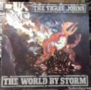 Discos de vinilo: THE THREE JOHNS - THE WORLD BY STORM LP ED ESPAÑOLA 1987. Lote 160358678