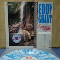 Discos de vinilo: EDDY GRANT - ROMANCING THE STONE 1984 GER , WHITE/BLUE MARBLED VINYL. Lote 162292358