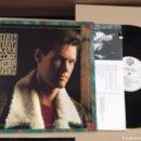 Discos de vinilo: RANDY TRAVIS AN OLD TIME CHRISTMAS ( CANADÁ). Lote 165389233