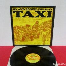 Discos de vinil: SLY & ROBBIE - PRESENT TAXI - LP - ISLAND 1981 GERMANY JIMMY RILEY JUNIOR DELGADO BLACK UHURO N MINT. Lote 169113272