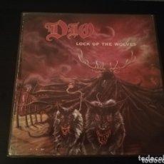 Discos de vinilo: DISCO VINILO ORIGINAL DIO LOCK UP THE WOLVES. Lote 172297210