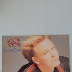 Discos de vinilo: JASON DONOVAN. HANG ON TO YOUR LOVE.. Lote 177661720