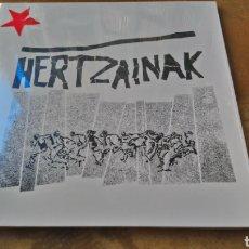 Discos de vinilo: HERTZAINAK - LP VINILO NUEVO PRECINTADO - ROCK RADIKAL VASCO. Lote 182574818