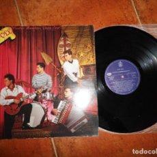 Discos de vinilo: OLE OLE CUATRO HOMBRES PARA EVA LP VINILO GATEFOLD DEL AÑO 1988 MARTA SANCHEZ CONTIENE 9 TEMAS. Lote 186221573