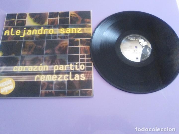GENIAL MAXI. ALEJANDRO SANZ - CORAZÓN PARTIO - REMEZCLAS. MADE IN GERMANY .WARNER MUSIC 3984 23094 (Música - Discos de Vinilo - Maxi Singles - Solistas Españoles de los 70 a la actualidad)