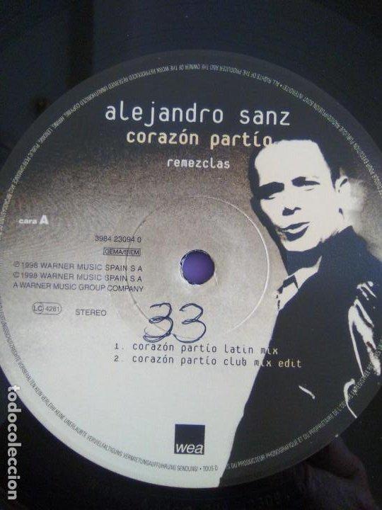 Discos de vinilo: GENIAL MAXI. ALEJANDRO SANZ - CORAZÓN PARTIO - REMEZCLAS. MADE IN GERMANY .WARNER MUSIC 3984 23094 - Foto 12 - 194219645