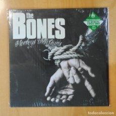 Discos de vinilo: THE BONES - MONKEYS WITH GUNS - LP. Lote 194328546