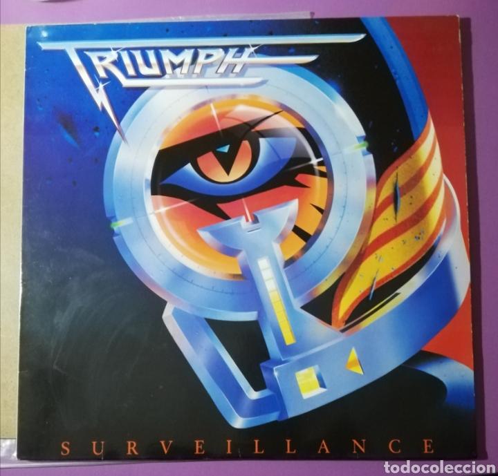 DISCO VINILO TRIUMPH-SURVEILLANCE. (Música - Discos - LP Vinilo - Heavy - Metal)