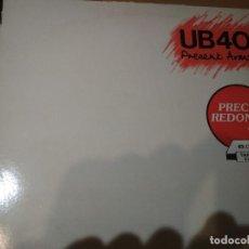 Discos de vinilo: UB40 PRESENT ARMS LP SPAIN. Lote 195414712