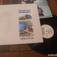 Discos de vinilo: LEVEL 42 LP. STARING AT THE SUN MADE IN SPAIN. 1988. DEFECTUOSO. Lote 195495267
