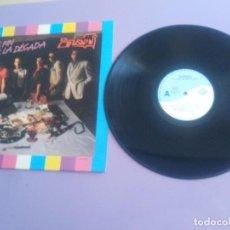 Discos de vinilo: LP. BURNIN EL FIN DE LA DECADA. DIVUCSA.EDITADO PERFIL 33.354 T B2- AÑO 1991.QUE HACE UNA CHICA.... Lote 197953477