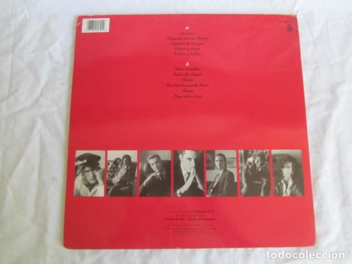 Discos de vinilo: LP vinilo Loquillo y los Trogloditas Hombres 1991 - Foto 2 - 203061738