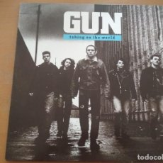 Discos de vinilo: GUN TAKING ON THE WORLD LP SPAIN 1989 INSERTO. Lote 208078380