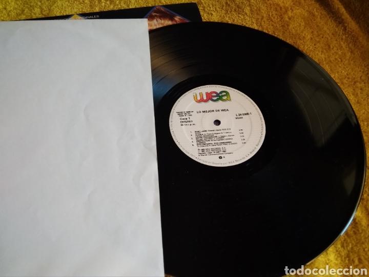 Discos de vinilo: 03-LP . Disco Vinilo. Wea. Varios artistas. Philp Collins, Rod Stewart...(Con saltos en 2 canciones) - Foto 3 - 212265855