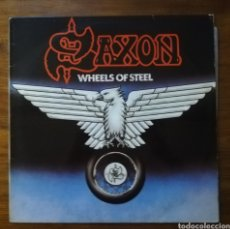 Discos de vinilo: SAXON WHEELS OF STEEL LP. Lote 216628423
