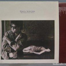 Discos de vinilo: LP. PAUL YONG. BETWEEN TWO FIRES. Lote 218318810