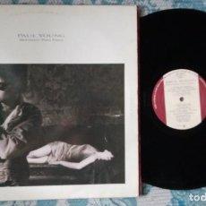 Discos de vinilo: LP PAUL YOUNG - BETWEEN TWO FIRES. Lote 218516706