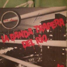Discos de vinilo: LA BANDA TRAPERA DEL RIO. LA REGLA.. Lote 224488183