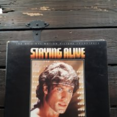 Discos de vinilo: LP. STAYING ALIVE.VG VG.JOHN TRAVOLTA.BEE GEES.FRANK STALLONE.DISCOS.PELICULAS.. Lote 233968125