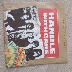 Discos de vinilo: TRAVELING WILBURYS HANDLE WITH CARE. Lote 235298535