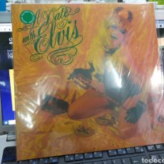 Discos de vinilo: THE CRAMPS LP A DATE WITH ELVIS PRECINTADO VINILO DE COLOR. Lote 236585755