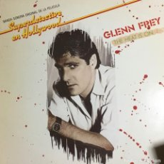 Discos de vinilo: GLENN FREY - THE HEAT IS ON SUPERDETECTIVE EN HOLLYWOOD. Lote 237591720