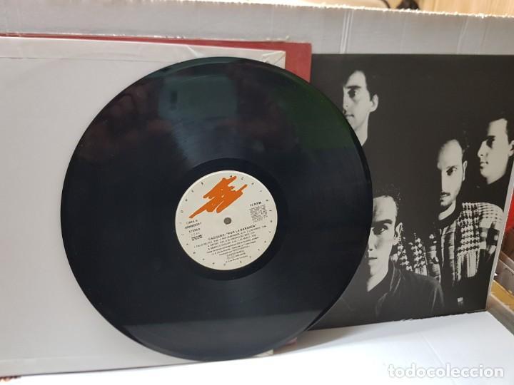 Discos de vinilo: LP-Los Caciques -Por la Baranda- en funda original 1993 - Foto 3 - 242900225