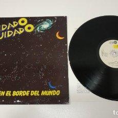 Discos de vinilo: 0221- CUIDADO CUIDADO EN EL BORDE DEL MUNDO SPAIN 1986 LP VIN POR VG+ DIS VG+. Lote 244414205