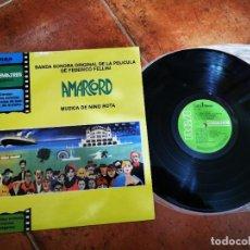 Discos de vinilo: AMARCORD BANDA SONORA NINO ROTA LP VINILO DEL AÑO 1980 REEDICION PORTADA AMARILLA 12 TEMAS. Lote 245404005